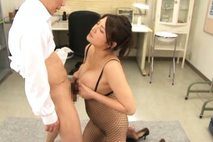Meguri. Meguri Asian in fishnet outfit rubs penis between her knockers